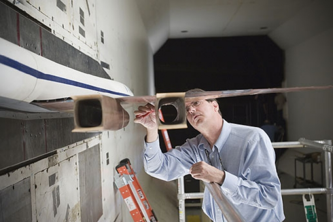 Transonic Dynamics Tunnel engineer Mark Sanetrik works on the SuperSonic SemiSpan Transport (S4T) model.