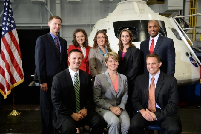Members of NASA's newest astronaut class pose with an Orion capsule at NASA's Johnson Space Center in Houston on Tuesday, Aug. 20, 2013.