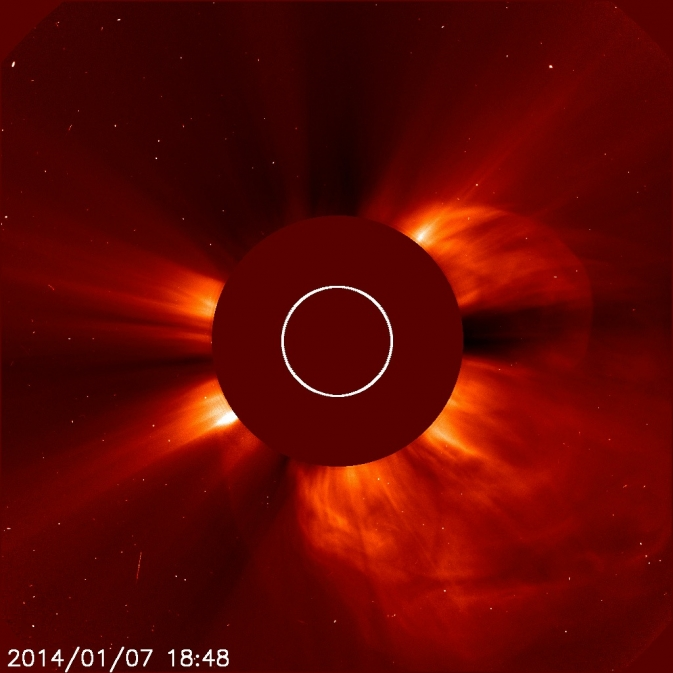 A giant cloud of solar particles, called a coronal mass ejection, explodes off the sun on Jan. 7, 2014.