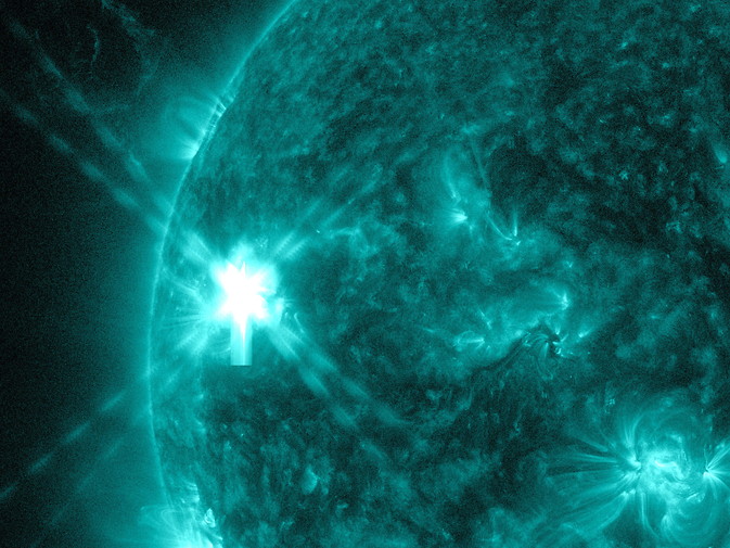 A mid-level flare, an M6.5, erupted on the left side of the sun on July 8, 2014.