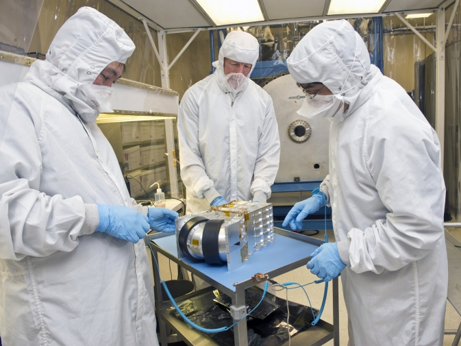 Engineers test an MMS Dual Ion Spectrometer in the clean tent.