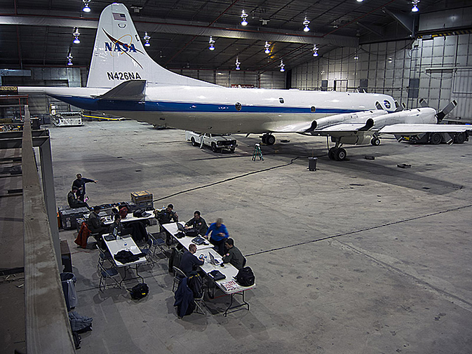 The NASA P-3B sits in the hangar at Thule Air Base while the IceBridge team waits for fog to clear.