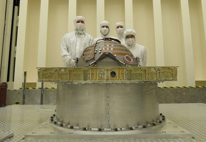 technicians and engineers with SMAP's propellant tank