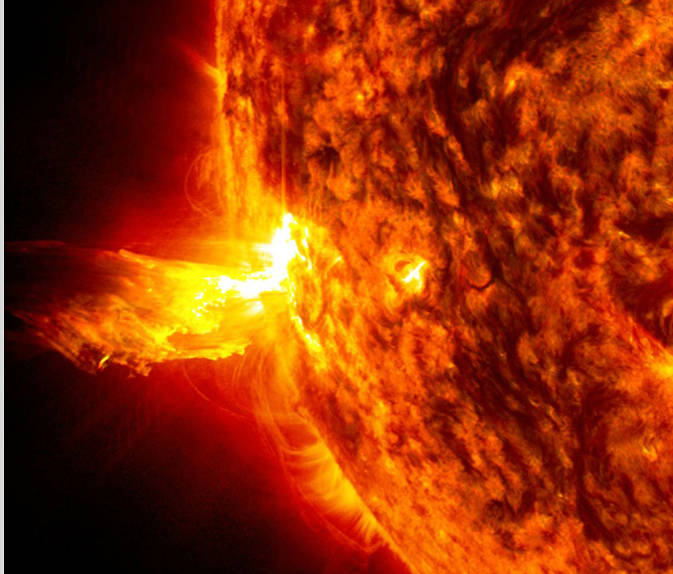 A solar flare and an eruption of solar material shooting through the sun's atmosphere, called a prominence eruption.