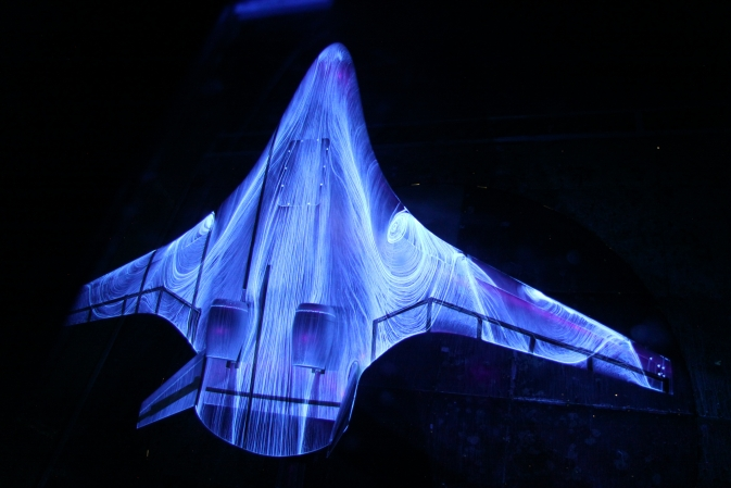 In this photo, engineers led by researcher Greg Gatlin have sprayed fluorescent oil on a 5.8 percent scale model of a futuristic hybrid wing body during tests in the14 by-22-Foot Subsonic Wind Tunnel at NASA's Langley Research Center.