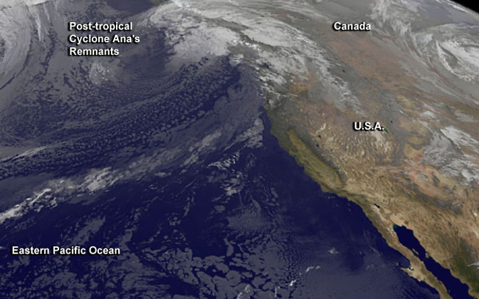 Post-tropical cyclone Ana's remnant clouds resemble a frontal system in this image from NOAA's GOES-West satellite.