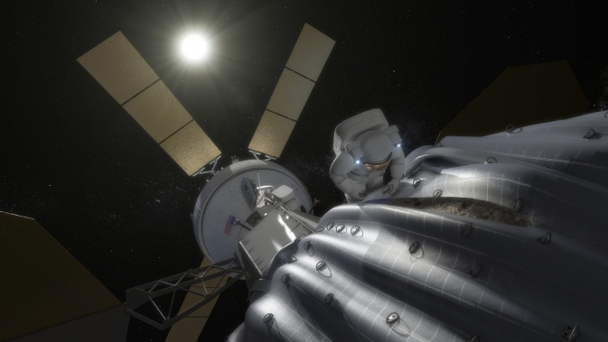 This concept image shows an astronaut preparing to take samples from the captured asteroid