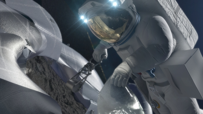 This concept image shows an astronaut retrieving a sample from a captured asteroid.