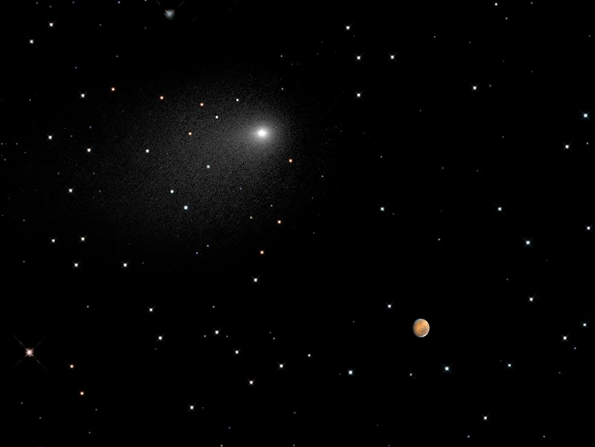 This composite NASA Hubble Space Telescope Image captures the positions of comet Siding Spring and Mars in a never-before-seen close passage of a comet by the Red Planet