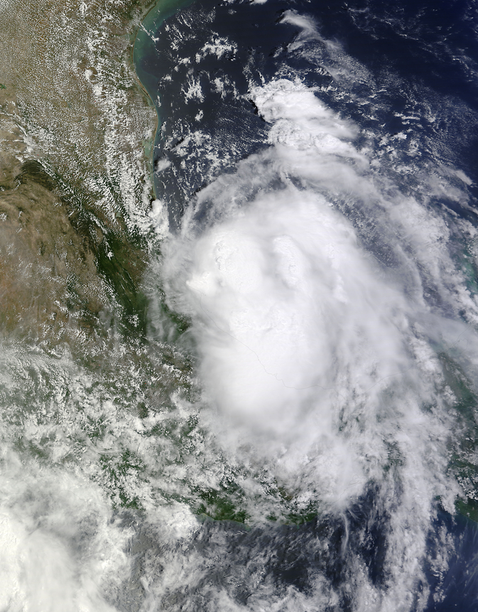 MODIS instrument aboard NASA's Terra satellite took this image of Tropical Storms Norbert (bottom left)  in the Eastern Pacific and Dolly (right) in the Gulf of Mexico at 1:30 p.m. EDT on Sept. 2, 2014