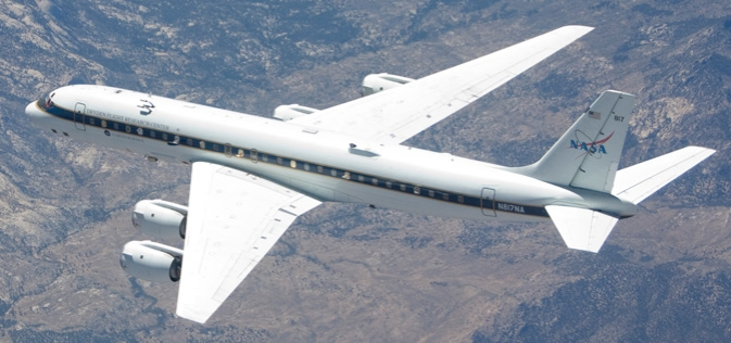 Numerous instrument probes protrude from NASA's DC-8 Airborne Science flying laboratory as it flies an instrument checkout flight.