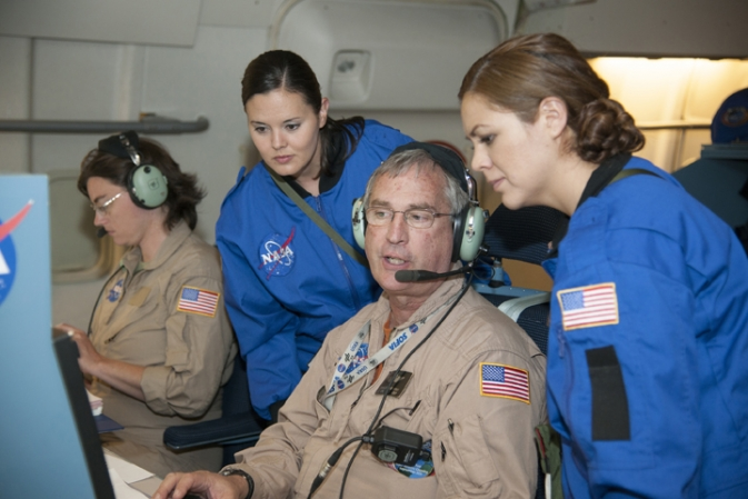 Karina Leppik, from left, Adriana Alvarez, mission manager Charlie Kaminski and Mariela Aguirre, observe mission information.