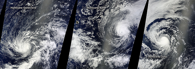 On Aug. 5, at 22:05 UTC (6:55 p.m. EDT) NASA's Terra satellite passed over Hurricane Genevieve (left), Hurricane Iselle (center), and Hurricane Julio (right) in the Central and  Eastern Pacific Oceans.