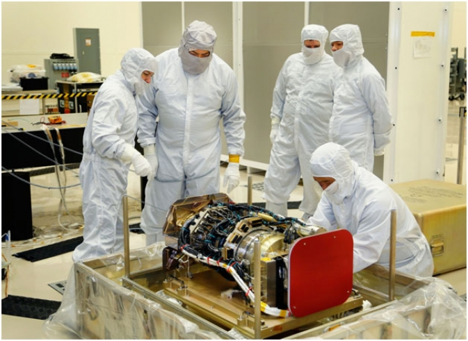 This photo shows members of the Lockheed Martin team hard at work in Denver as they unpack the Solar Ultraviolet Imager (SUVI) instrument after delivery and prepare it for integration with the spacecraft.