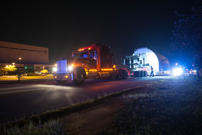 The Webb backplane is being unloaded from a trailer truck at the Goddard Space Flight Center  in Greenbelt, MD, where it currently resides in Goddard's giant cleanroom.