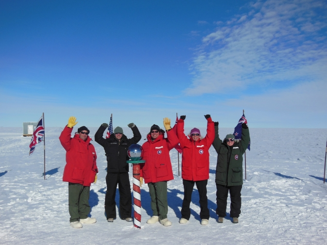The IceBridge team and members of the 109th AW strike a pose at the South Pole.
