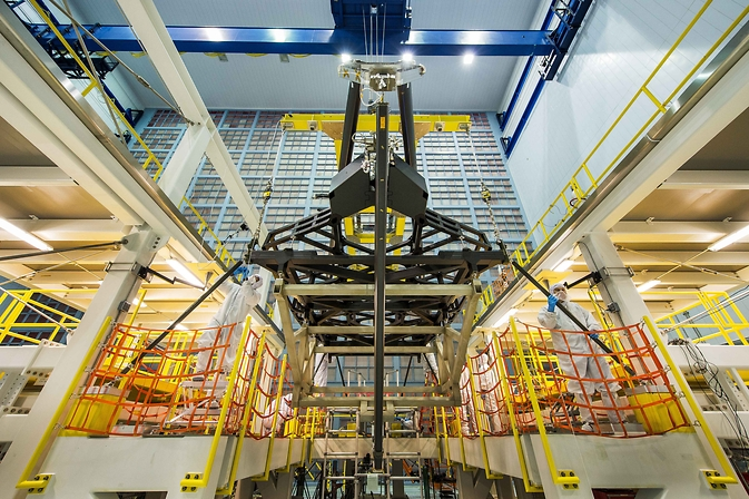 "The Webb telescope's ""pathfinder"" backplane hoisted up the cleanroom at NASA Goddard."