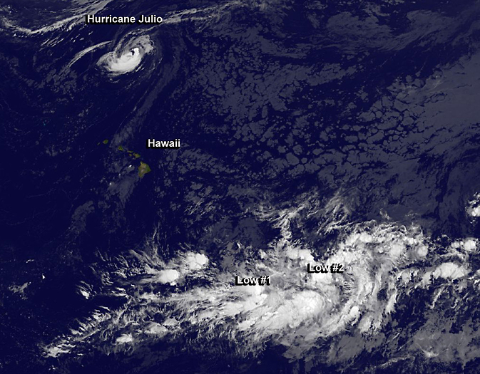 Tropical Storm Julio far north of Hawaii, while two developing tropical lows are southeast of the islands.