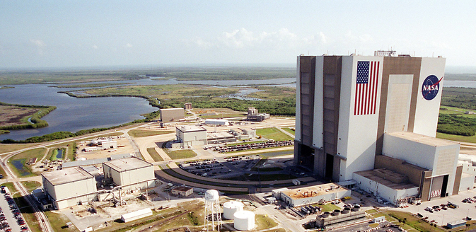 File image from June 20, 2001 shows Orbiter Processing Facility 1 and 2 (left) and Vehicle Assembly Building (right) at NASA's Kennedy Space Center in Florida.