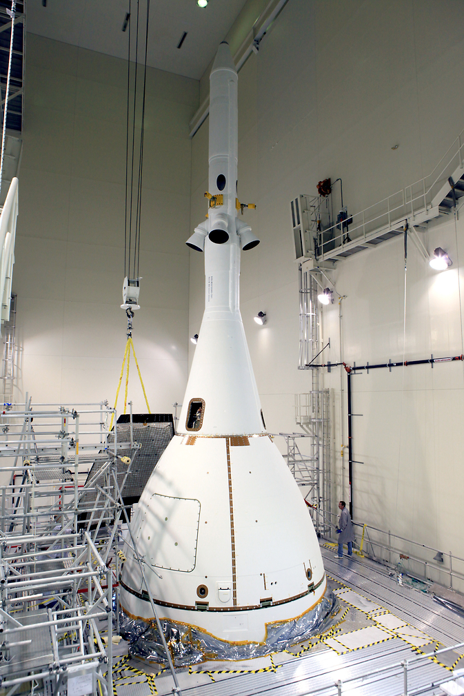 Inside the Launch Abort System Facility at NASA's Kennedy Space Center in Florida, a crane brings the fourth and final Ogive panel closer for installation on Orion's Launch Abort System.