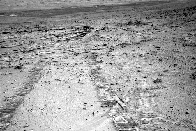 "NASA's Mars Rover Curiosity looks back at wheel tracks made during the first drive away from the last science target in the ""Glenelg"" area"