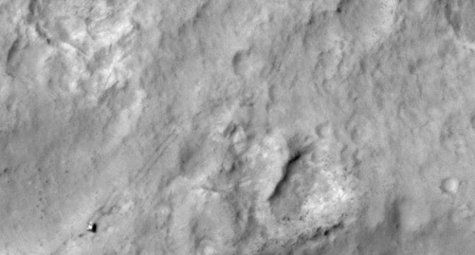 NASA's Curiosity Mars rover and tracks
