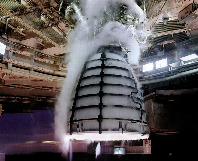 Four RS-25 engines, like the one pictured undergoing a hot-fire test, will power the core stage of NASA's Space Launch System (SLS) -- NASA's new heavy-lift launch vehicle.