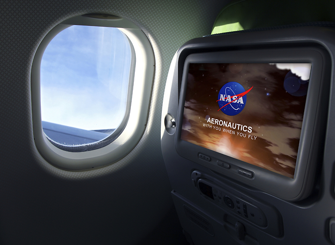 Inside an airplane at a window seat with NASA Aeronautics on the screen.