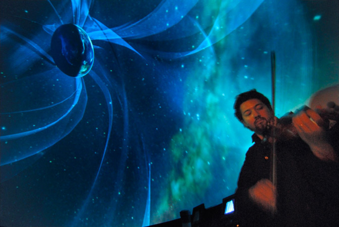 man playing violin over backdrop of Earth's magnetosphere