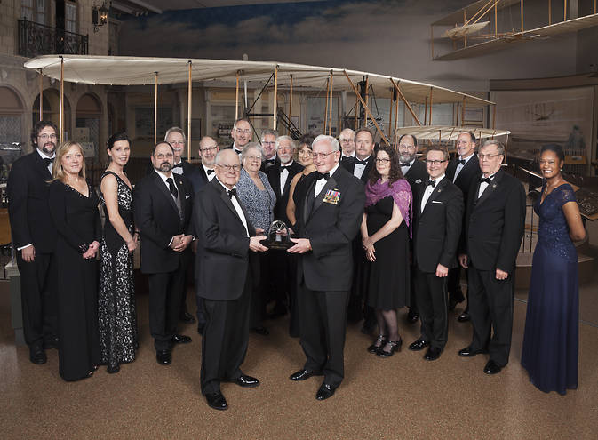 "Gen. John ""Jack"" R. Dailey (front right), director of the Museum, presents the 2015 Current Achievement Trophy Award to William"