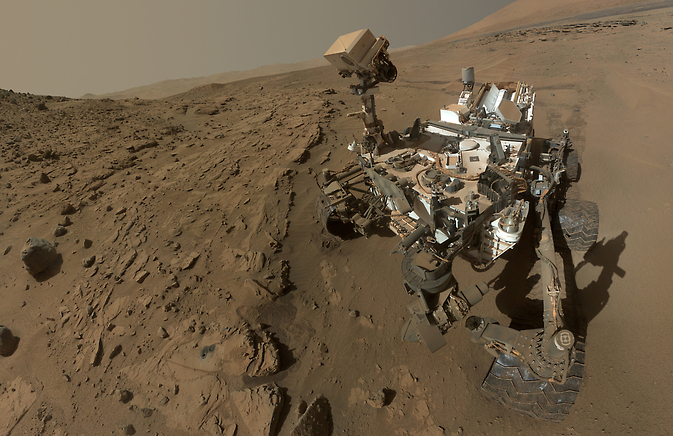 "Curiosity component images combined into a self-portrait at drilling target ""Windjana."""