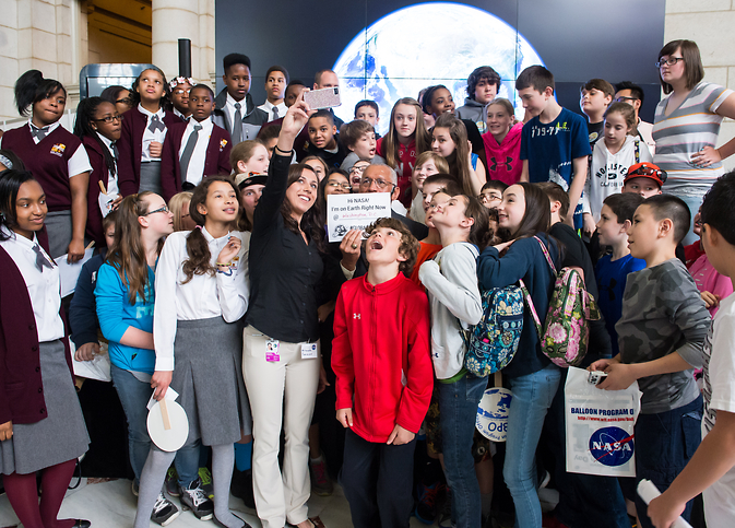 NASA Administrator Charles Bolden poses for a quick selfie with students who attended the NASA sponsored Earth Day event.