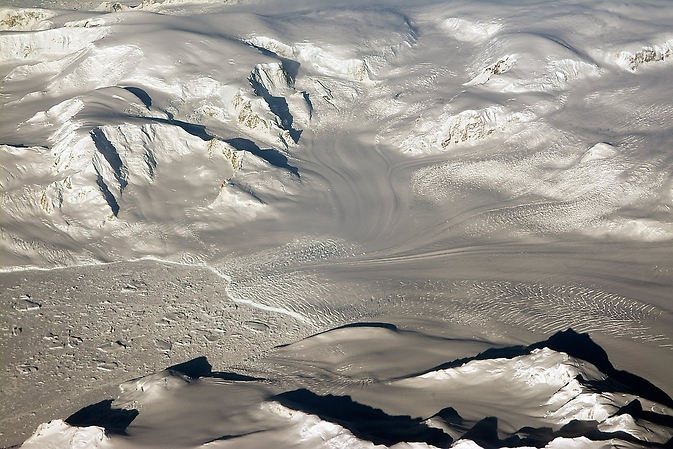 Glaciers and mountains in the evening sun are seen on an Operation IceBridge research flight, returning from West Antarctica on