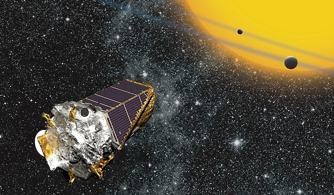 Artist's conception of the Kepler space telescope observing planets transiting a distant star.