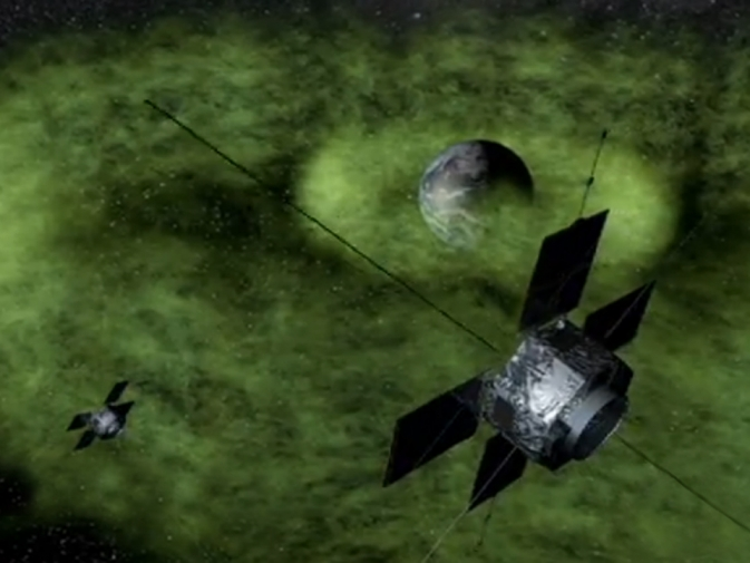 Artist's rendition of Earth's radiation belts with the twin Van Allen Probes traveling through them.
