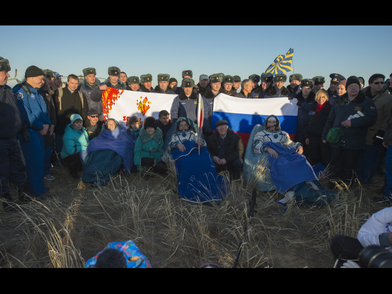Expedition 37 Lands, Brings Olympic Torch Back to Earth