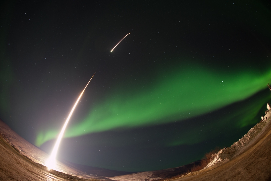 A NASA-funded sounding rocket launches into an aurora in the early morning of March 3, 2014, over Venetie, Alaska.