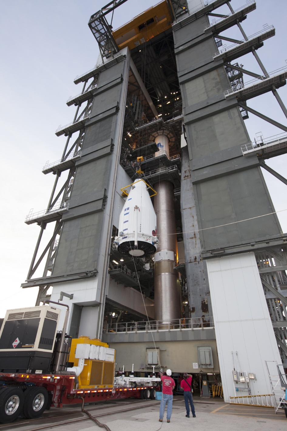 NASA's MAVEN (Mars Atmosphere and Volatile EvolutioN) spacecraft, inside a payload fairing, is hoisted to the top of a United Launch Alliance Atlas V rocket at the Vertical Integration Facility at Cape Canaveral Air Force Station's Space Launch Complex 41.