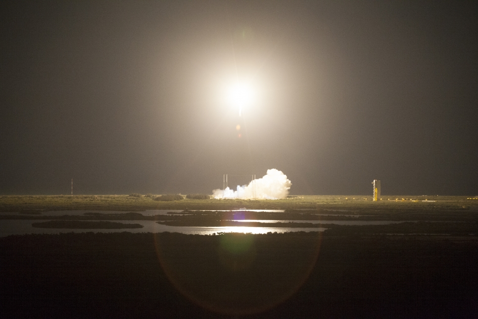 A United Launch Alliance Atlas V rocket lights up the night sky over Space Launch Complex 41 at Cape Canaveral Air Force Station in Florida as it carries NASA's Tracking and Data Relay Satellite, or TDRS-L, to Earth orbit