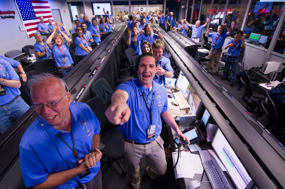 The Mars Science Laboratory (MSL) team in the MSL Mission Support Area reacts after learning the Curiosity rover has landed safely on Mars and images start coming into the Jet Propulsion Laboratory, Sunday, Aug. 5, 2012 in Pasadena, Calif. The MSL Rover named Curiosity was designed to assess whether Mars ever had an environment able to support small life forms called microbes.