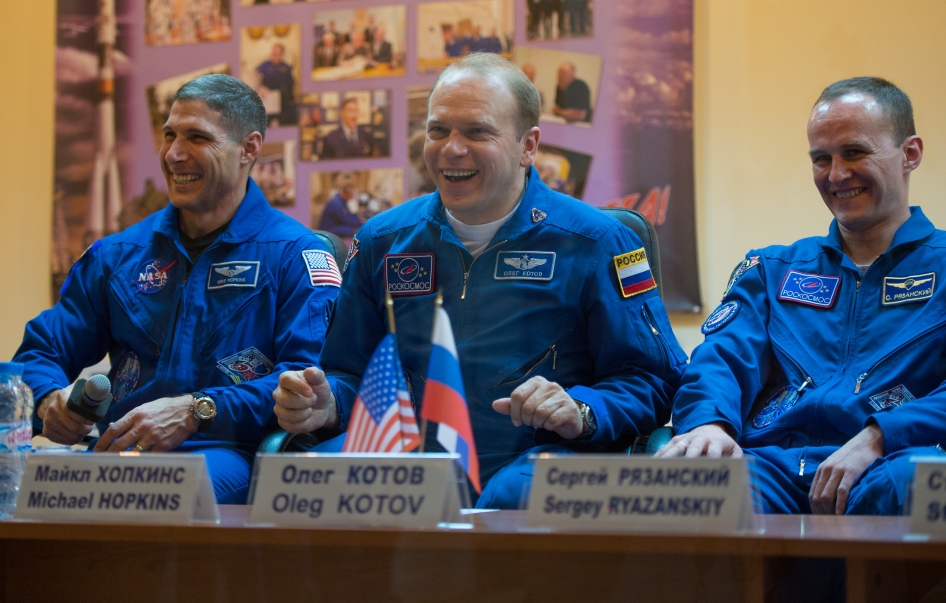 Expedition 37 NASA Flight Engineer Michael Hopkins, far left, Soyuz Commander Oleg Kotov and Russian Flight Engineer Sergey Ryazanskiy, far right, share a laugh at a press conference held at the Cosmonaut Hotel, on Tuesday, Sept. 24, 2013, in Baikonur, Kazakhstan.