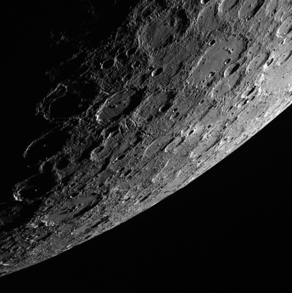 In this scene, which was acquired by the MESSENGER spacecraft looking from the shadows toward the sunlit side of the planet Mercury, a 120-km (75 mi.) impact crater stands out near the center.