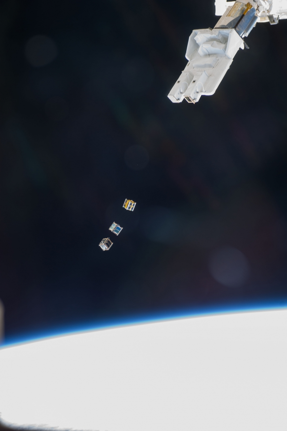 Three nanosatellites, known as Cubesats, are deployed from a Small Satellite Orbital Deployer (SSOD) attached to the Kibo laboratory's robotic arm at 7:10 a.m. (EST) on Nov. 19, 2013.