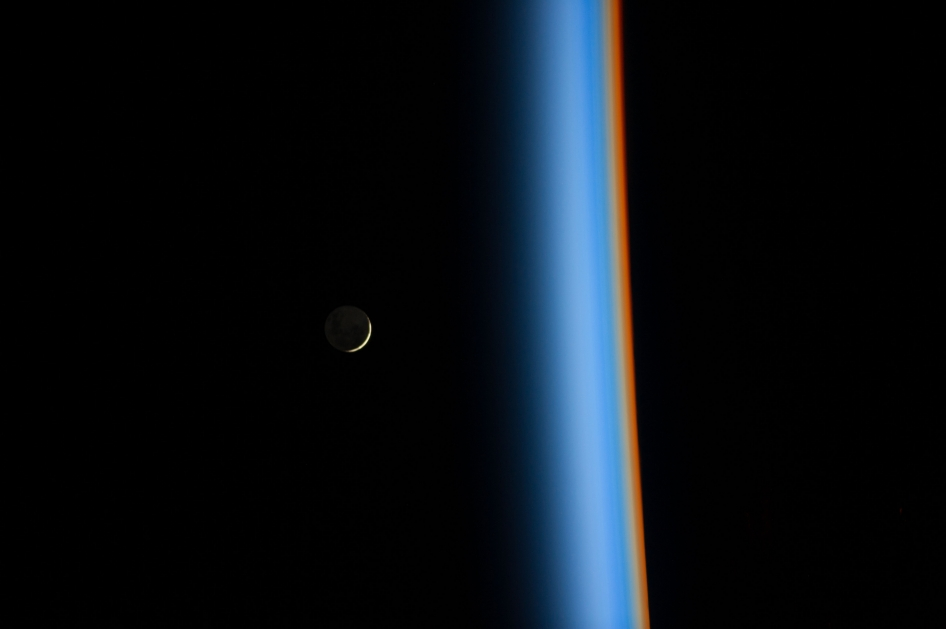 On Feb. 1, 2014, Japan Aerospace Exploration Agency astronaut Koichi Wakata tweeted this view of a crescent moon rising and the cusp of Earth's atmosphere.