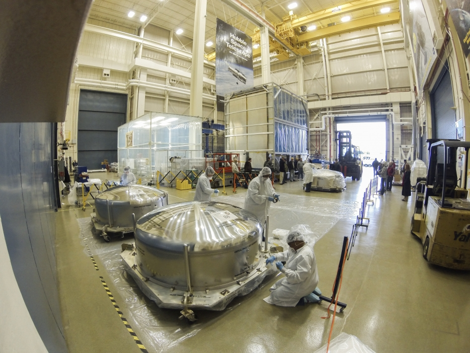 technicians inspect Webb telescope mirror segment shipping containers