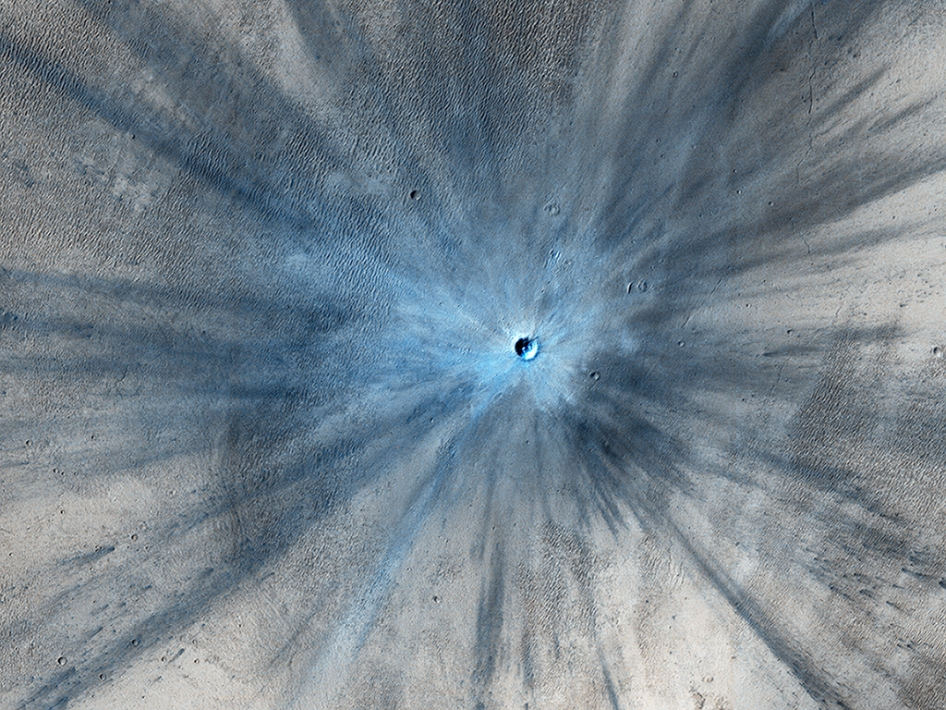 A dramatic, fresh impact crater dominates this image taken by the High Resolution Imaging Science... [+] Experiment (HiRISE) camera on NASA's Mars Reconnaissance Orbiter on Nov. 19, 2013. Researchers used HiRISE to examine this site because the orbiter's Context Camera had revealed a change in appearance here between observations in July 2010 and May 2012, bracketing the formation of the crater between those observations. Image credit: NASA/JPL-Caltech/Univ. of Arizona
