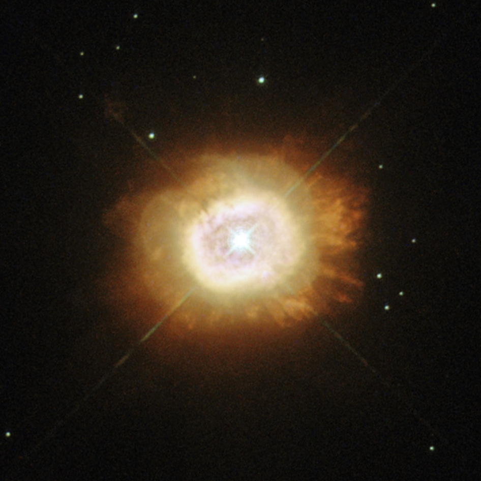 brilliant star with lens-rays surrounded by orange vapor