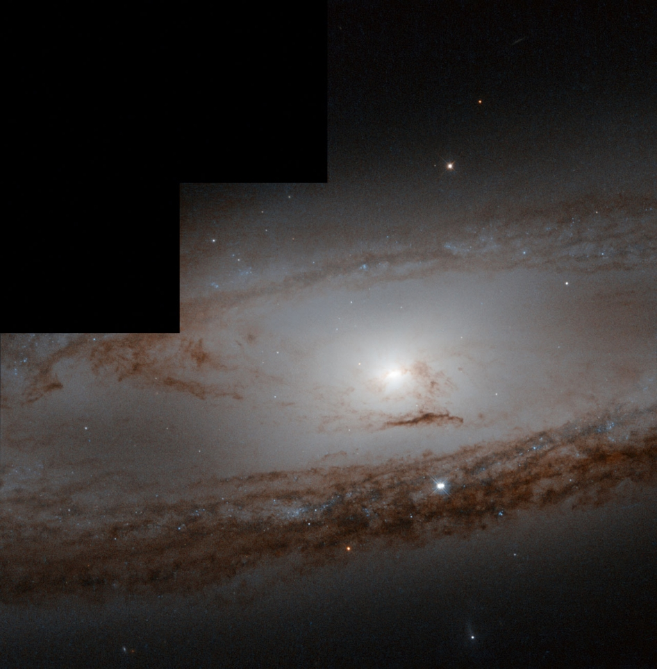 classic stepped hubble image of milky white galaxy with rusty dust lanes