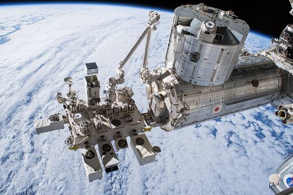 image of exterior experiment module with Earth in backdrop
