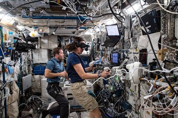 image of astronauts working with VR experiment